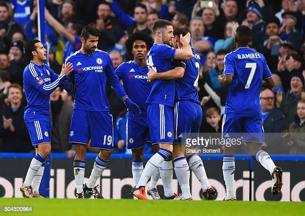Diego Costa of Chelsea celebrates with team mates as he scores their first goal during the Emirates FA Cup third round match between Chelsea and...