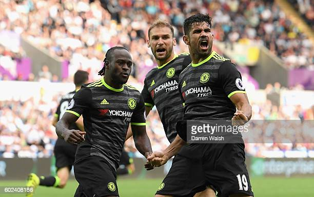 Diego Costa of Chelsea celebrates with team mates Victor Moses and Branislav Ivanovic as he scores their second goal during the Premier League match...