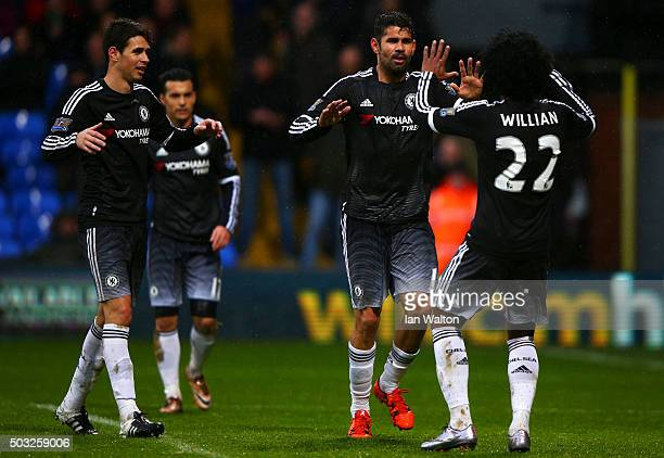 Diego Costa of Chelsea celebrates with teammates after scoring his team's third goal during the Barclays Premier League match between Crystal Palace...