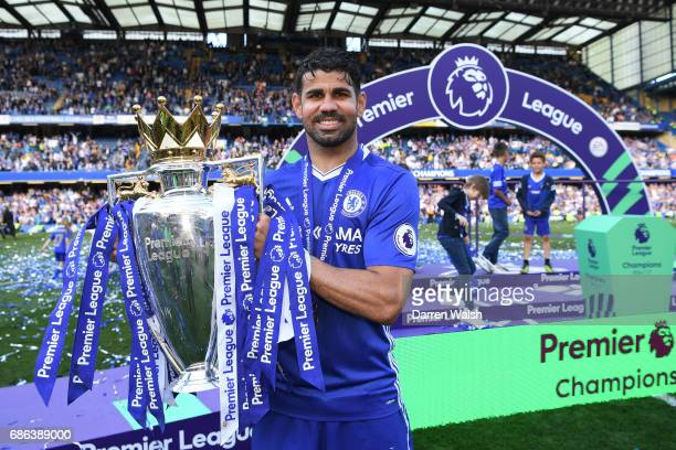 Diego Costa of Chelsea celebrates with the Premier League Trophy after the Premier League match between Chelsea and Sunderland at Stamford Bridge on...