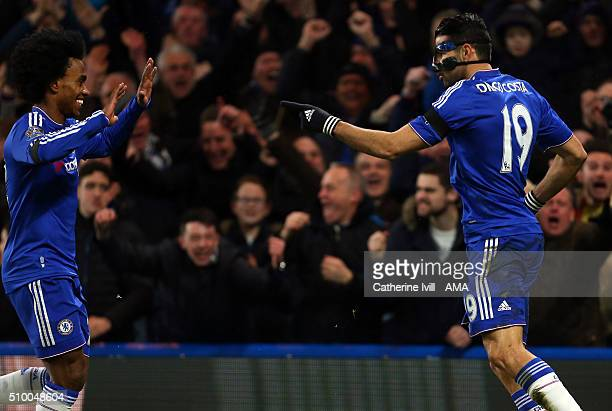 Diego Costa of Chelsea celebrates with Willian of Chelsea during the Barclays Premier League match between Chelsea and Newcastle United at Stamford...