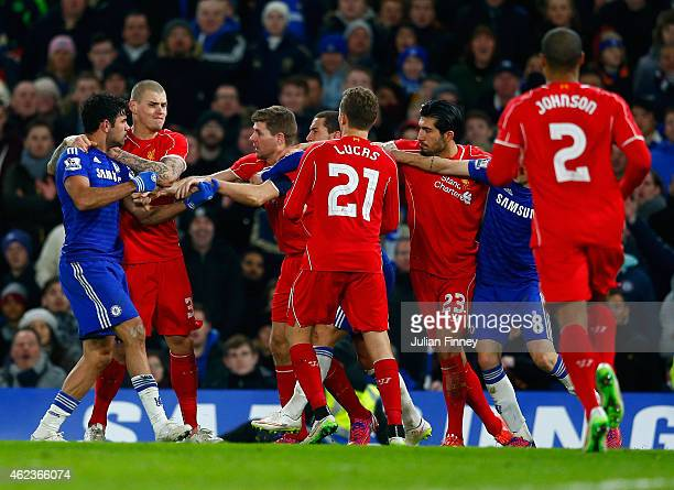 Diego Costa of Chelsea clashes with Martin Skrtel, Steven Gerrard and Emre Can of Liverpool during the Capital One Cup Semi-Final second leg between...
