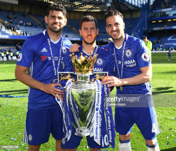 Diego Costa of Chelsea Eden Hazard of Chelsea and Cesc Fabregas of Chelsea pose with the Premier League Trophy after the Premier League match between...