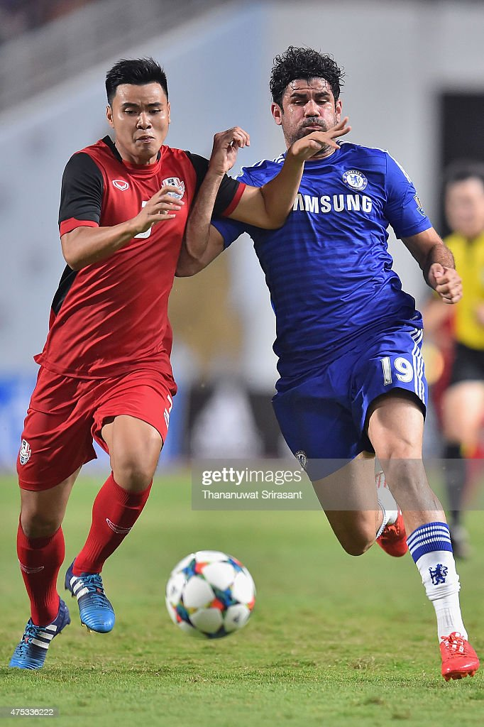 Diego Costa #19 of Chelsea FC (R) and Suwannapat Kingkaew #3 of Thailand All-Stars (L) competes for the ball during the international friendly match between Thailand All-Stars and Chelsea FC at Rajamangala Stadium on May 30, 2015 in Bangkok, Thailand.