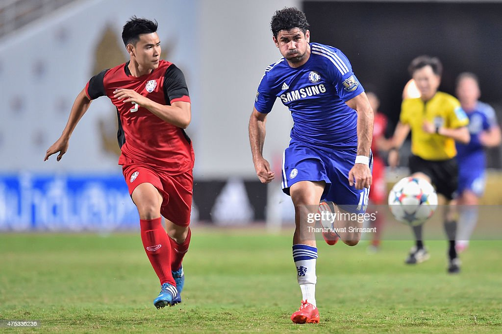 Diego Costa #19 of Chelsea FC (R) and Suwannapat Kingkaew #3 of Thailand All-Stars (L) runs to the ball during the international friendly match between Thailand All-Stars and Chelsea FC at Rajamangala Stadium on May 30, 2015 in Bangkok, Thailand.