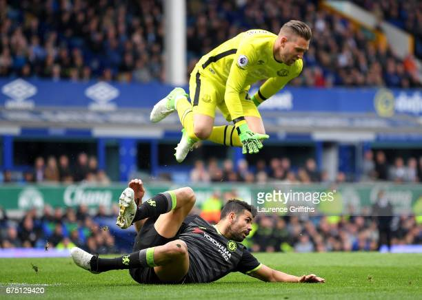 Diego Costa of Chelsea fouls Maarten Stekelenburg of Everton during the Premier League match between Everton and Chelsea at Goodison Park on April...