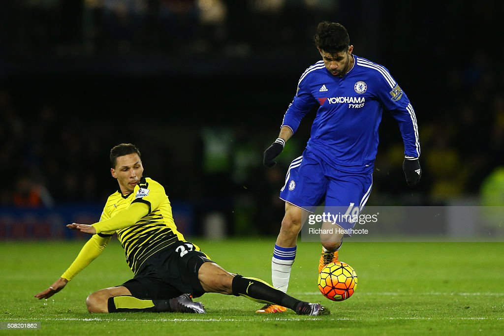 Diego Costa of Chelsea goes past the challenge from Jose Holebas of Watford during the Barclays Premier League match between Watford and Chelsea at Vicarage Road on February 3, 2016 in Watford, England.