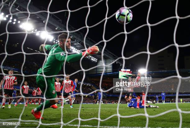 Diego Costa of Chelsea heads past Fraser Forster of Southampton to score their third goal during the Premier League match between Chelsea and...