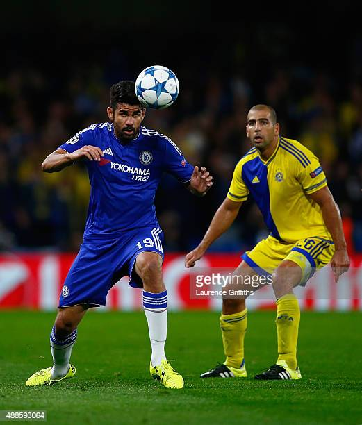 Diego Costa of Chelsea heads the ball under the watchful eye of Tal Ben Haim I of Maccabi Tel Aviv during the UEFA Chanmpions League group G match...