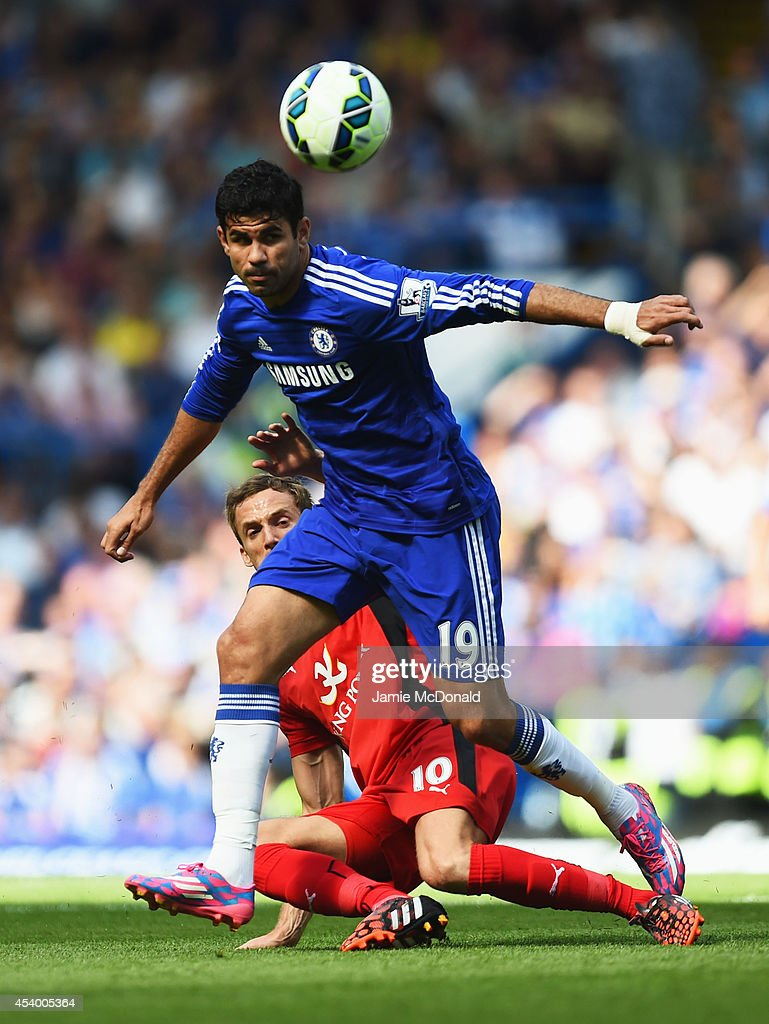 Diego Costa of Chelsea holds off Andy King of Leicester City during the Barclays Premier League match between Chelsea and Leicester City at Stamford Bridge on August 23, 2014 in London, England.