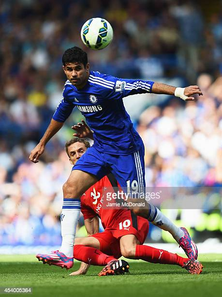 Diego Costa of Chelsea holds off Andy King of Leicester City during the Barclays Premier League match between Chelsea and Leicester City at Stamford...