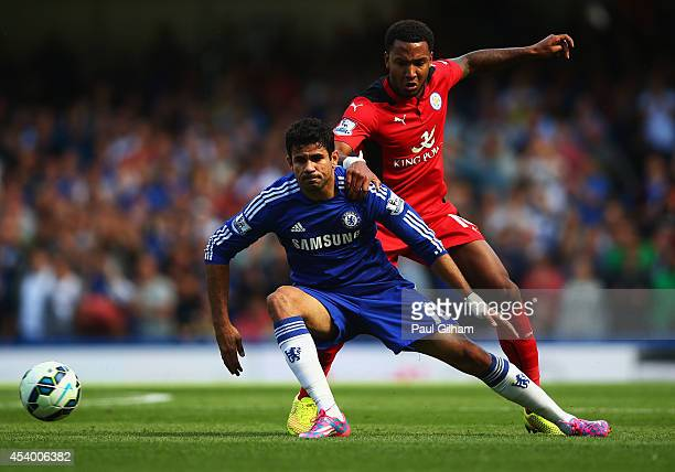Diego Costa of Chelsea holds off Liam Moore of Leicester City during the Barclays Premier League match between Chelsea and Leicester City at Stamford...