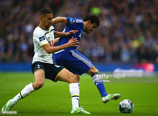 Diego Costa of Chelsea holds off Nabil Bentaleb of Spurs uring the Capital One Cup Final match between Chelsea and Tottenham Hotspur at Wembley...