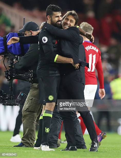 Diego Costa of Chelsea hugs Chelsea manager Antonio Conte during the Premier League match between Middlesbrough and Chelsea at Riverside Stadium on...