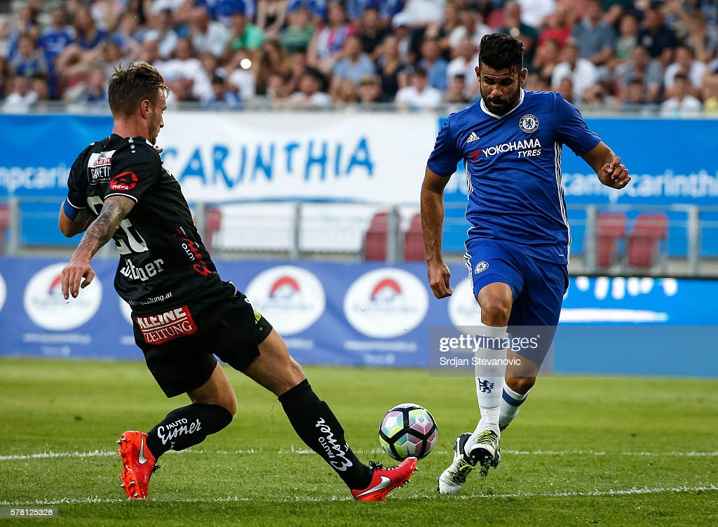 Diego Costa (R) of Chelsea in action against Michael Sollbauer (L) of WAC RZ Pellets during the friendly match between WAC RZ Pellets and Chelsea F.C. at Worthersee Stadion on July 20, 2016 in Velden, Austria.