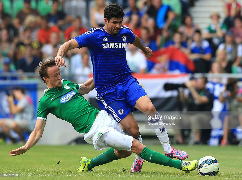 Diego Costa (R) of Chelsea is challenged by Antonio Mlinar Delamea (L) of FC Olimpija Ljubljana during the Pre Season Friendly match between FC Olimpija Ljubljana and Chelsea at Stozice stadium in Ljubljana, Slovenia on Sunday, July 27, 2014.
