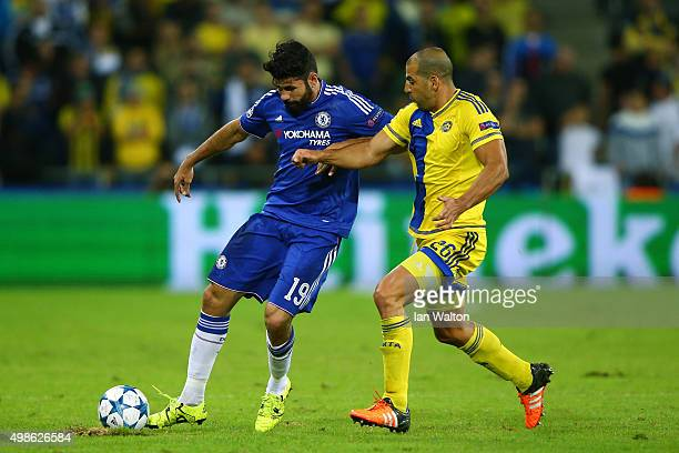 Diego Costa of Chelsea is closed down by Tal Ben Haim of Maccabi TelAviv during the UEFA Champions League Group G match between Maccabi TelAviv FC...