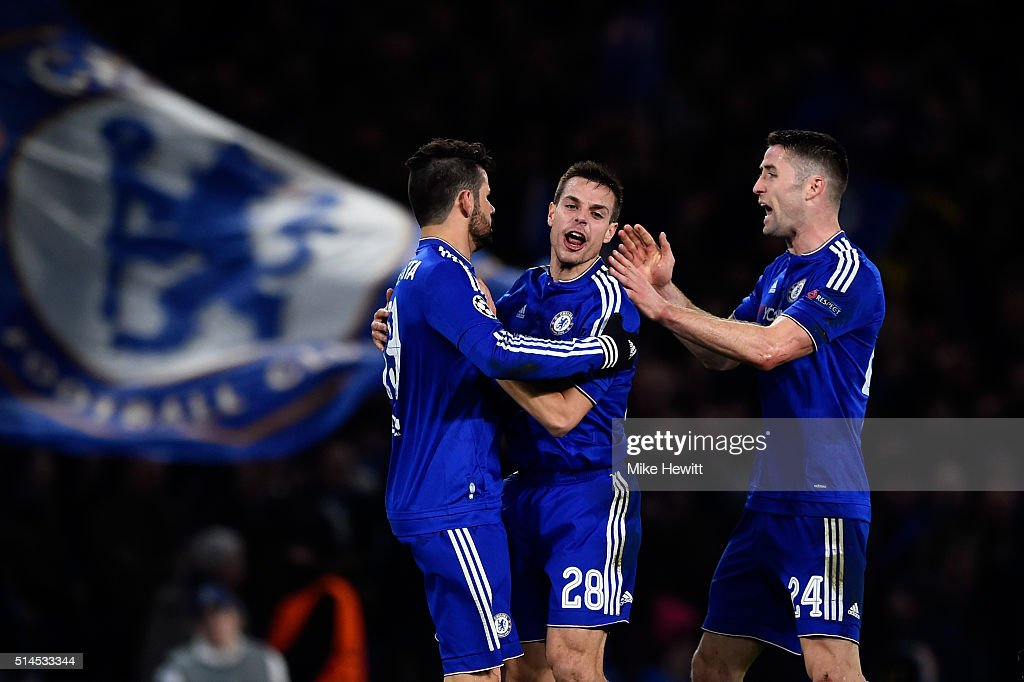 Diego Costa of Chelsea is congratulated by teammates Cesar Azpilicueta and Gary Cahill after scoring a goal to level the scores at 1-1 during the UEFA Champions League round of 16, second leg match between Chelsea and Paris Saint Germain at Stamford Bridge on March 9, 2016 in London, United Kingdom.