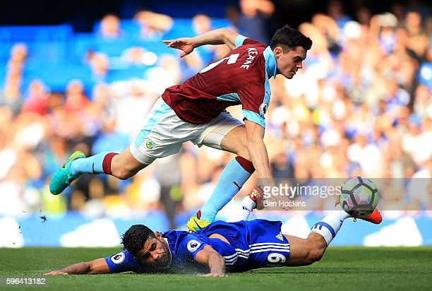 Diego Costa of Chelsea is fouled by Michael Keane of Burnley during the Premier League match between Chelsea and Burnley at Stamford Bridge on August...