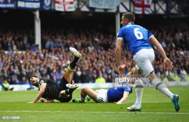 Diego Costa of Chelsea is fouled by Tom Davies of Everton during the Premier League match between Everton and Chelsea at Goodison Park on April 30...