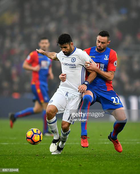 Diego Costa of Chelsea is held by Jordon Mutch of Crystal Palace during the Premier League match between Crystal Palace and Chelsea at Selhurst Park...