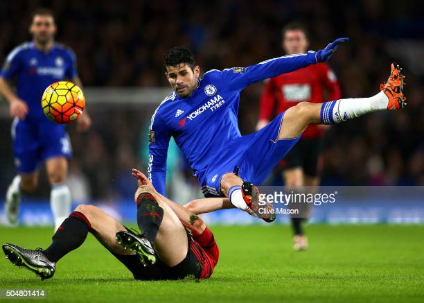 Diego Costa of Chelsea is tackled by Jonny Evans of West Bromwich Albion during the Barclays Premier League match between Chelsea and West Bromwich...