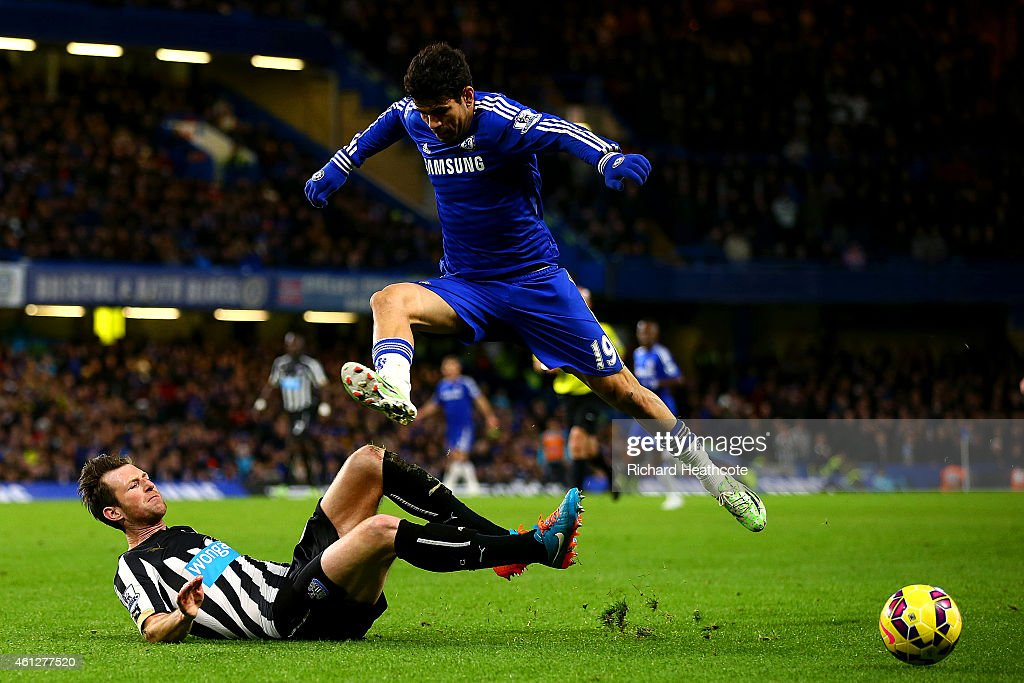 Diego Costa of Chelsea jumps over a challenge from Michael Williamson of Newcastle United during the Barclays Premier League match between Chelsea and Newcastle United at Stamford Bridge on January 10, 2015 in London, England.