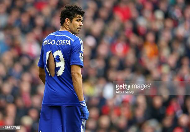 Diego Costa of Chelsea looks on with a ripped shirt during the Barclays Premier League match between Liverpool and Chelsea at Anfield on November 8...