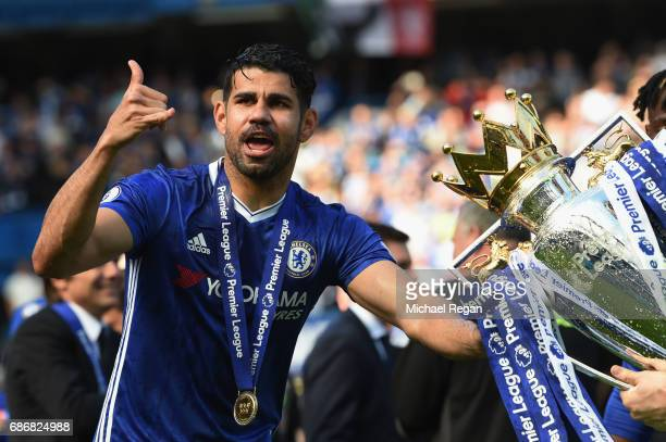 Diego Costa of Chelsea poses with the Premier League Trophy after the Premier League match between Chelsea and Sunderland at Stamford Bridge on May...
