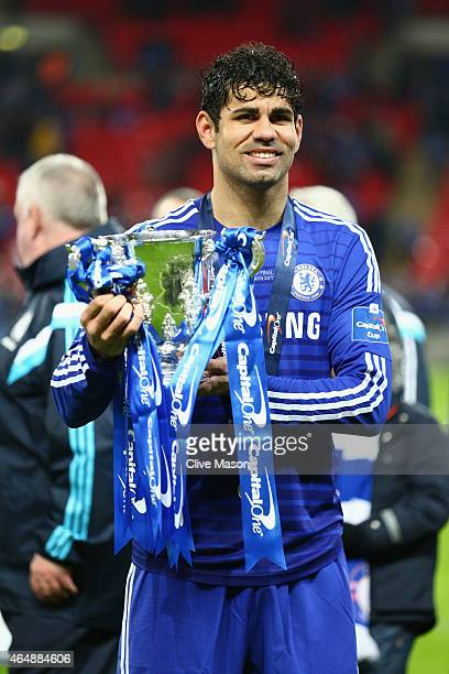 Diego Costa of Chelsea poses with the trophy after the Capital One Cup Final match between Chelsea and Tottenham Hotspur at Wembley Stadium on March...