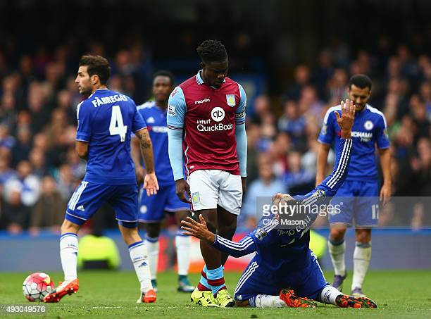 Diego Costa of Chelsea reacts after a challenge by Micah Richards of Aston Villa during the Barclays Premier League match between Chelsea and Aston...