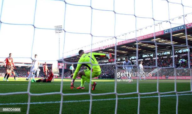 Diego Costa of Chelsea scores his sides first goal during the Premier League match between AFC Bournemouth and Chelsea at Vitality Stadium on April 8...