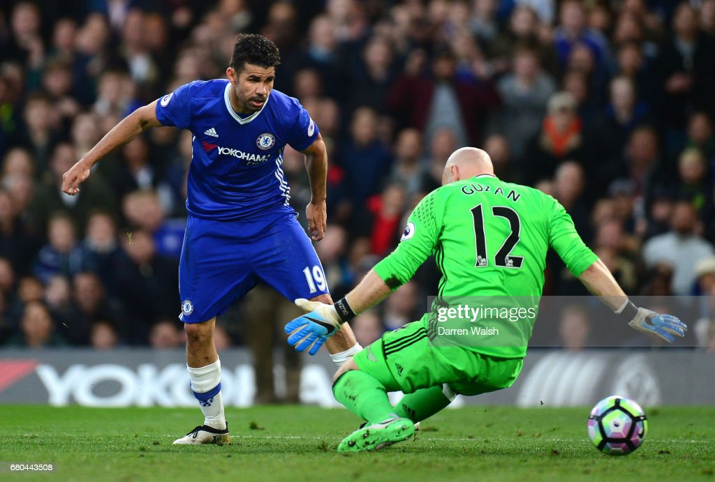 Diego Costa of Chelsea scores his sides first goal past Brad Guzan of Middlesbrough during the Premier League match between Chelsea and Middlesbrough at Stamford Bridge on May 8, 2017 in London, England.