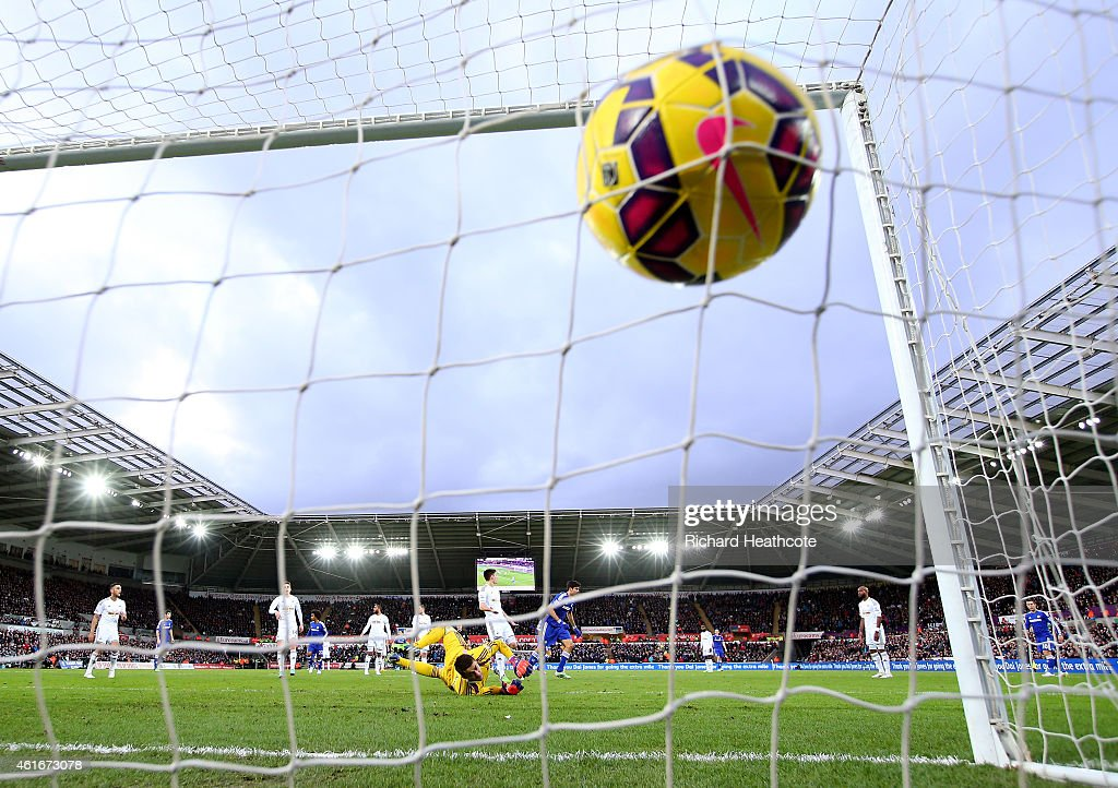 Diego Costa of Chelsea scores his team's second goal past Lukasz Fabianski of Swansea City during the Barclays Premier League match between Swansea City and Chelsea at Liberty Stadium on January 17, 2015 in Swansea, Wales.