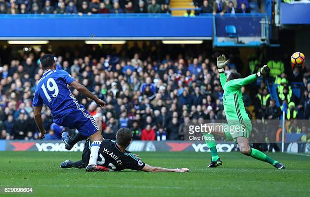 Diego Costa of Chelsea scores the opening goal past Ben Foster of West Bromwich Albion during the Premier League match between Chelsea and West...