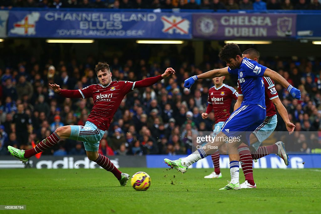 Diego Costa of Chelsea scores their second goal during the Barclays Premier League match between Chelsea and West Ham United at Stamford Bridge on December 26, 2014 in London, England.