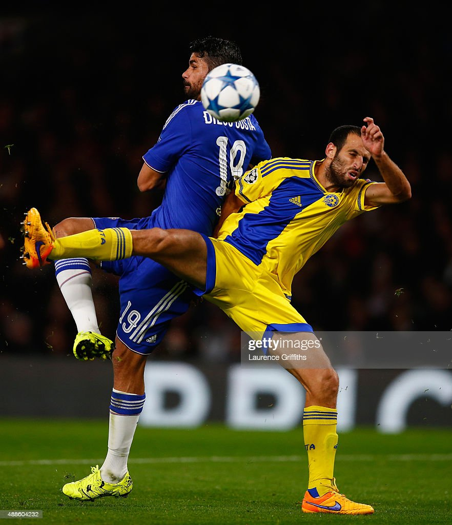 Diego Costa of Chelsea scores their third goal under pressure from Yuval Shpungin of Maccabi Tel Aviv during the UEFA Chanmpions League group G match between Chelsea and Maccabi Tel-Aviv FC at Stamford Bridge on September 16, 2015 in London, United Kingdom.
