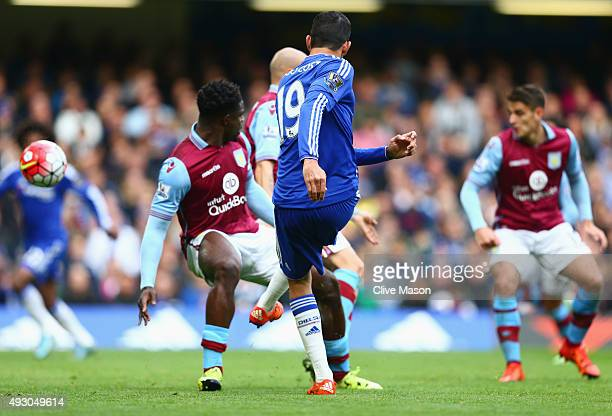 Diego Costa of Chelsea shoots at goal resulting in the own goal by Alan Hutton of Aston Villa during the Barclays Premier League match between...