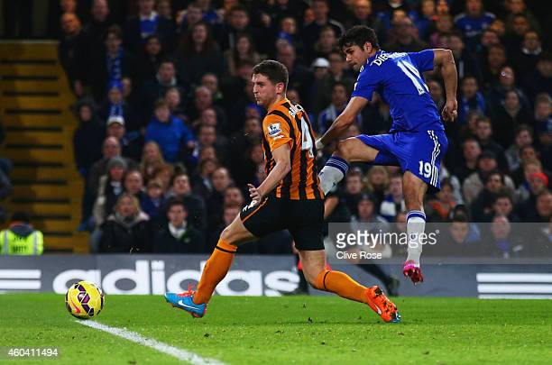 Diego Costa of Chelsea shoots past Alex Bruce of Hull City to score their second goal during the Barclays Premier League match between Chelsea and...
