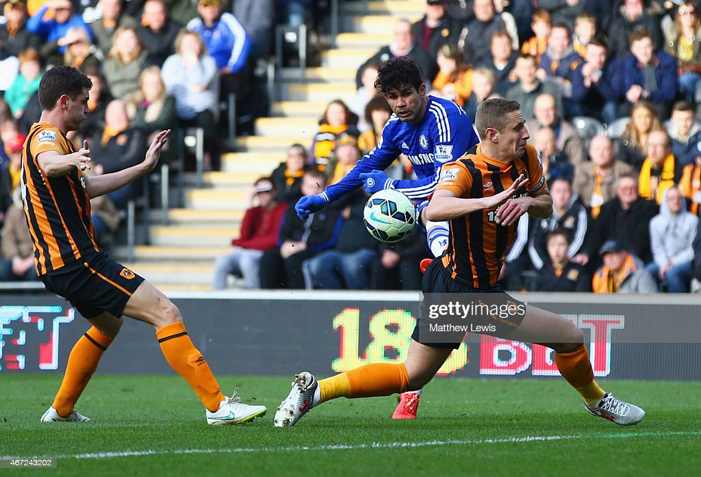 Diego Costa of Chelsea (C) shoots past Michael Dawson of Hull City to score their second goal during the Barclays Premier League match between Hull City and Chelsea at KC Stadium on March 22, 2015 in Hull, England.