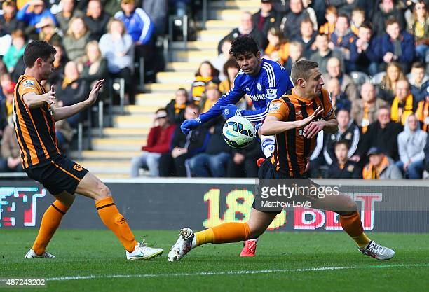 Diego Costa of Chelsea shoots past Michael Dawson of Hull City to score their second goal during the Barclays Premier League match between Hull City...