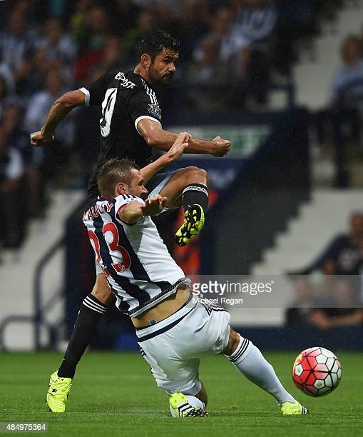 Diego Costa of Chelsea shoots under a challenge by Gareth McAuley of West Bromwich Albion during the Barclays Premier League match between West...