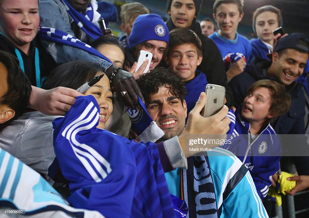Diego Costa of Chelsea signs autographs after the international friendly match between Sydney FC and Chelsea FC at ANZ Stadium on June 2, 2015 in Sydney, Australia.