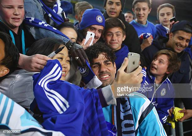 Diego Costa of Chelsea signs autographs after the international friendly match between Sydney FC and Chelsea FC at ANZ Stadium on June 2 2015 in...