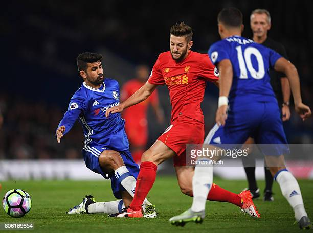 Diego Costa of Chelsea tackles Adam Lallana of Liverpool uring the Premier League match between Chelsea and Liverpool at Stamford Bridge on September...