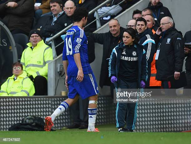 Diego Costa of Chelsea talks to team doctor Eva Carneiro as he is substituted during the Barclays Premier League match between Hull City and Chelsea...