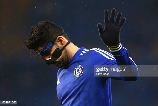 Diego Costa of Chelsea wearing a face mask warms up prior to the Barclays Premier League match between Chelsea and Newcastle United at Stamford...