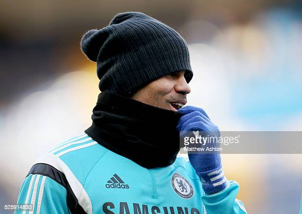 Diego Costa of Chelsea wearing a hat snood and gloves