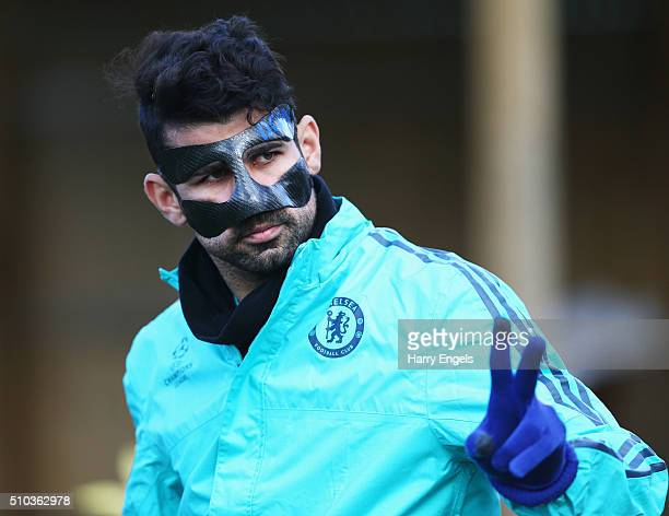 Diego Costa of Chelsea wears a protective face mask during a Chelsea training session ahead of their UEFA Champions League round of 16 match against...