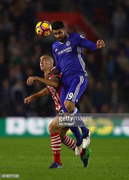 Diego Costa of Chelsea wins a header over Oriol Romeu of Southampton during the Premier League match between Southampton and Chelsea at St Mary's...